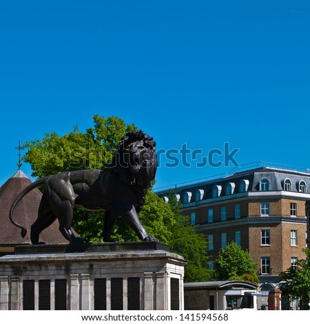 The Maiwand Lion at Forbury Gardens in Reading, England (square crop, plenty copy-space on blue sky)