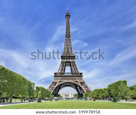 The majestic Eiffel tower in Paris against a blue sky