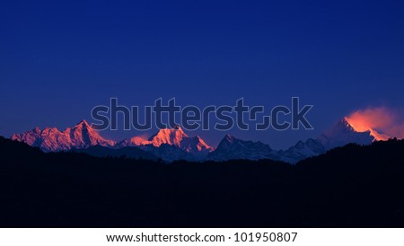 The majestic Kanchenjunga range of the himalayas at first light of sunrise at Sikkim , India