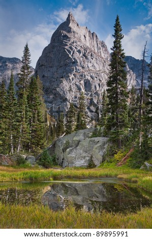 The majestic Lone Eagle Peak in the Indian Peaks Wilderness looms over a mirrored pond