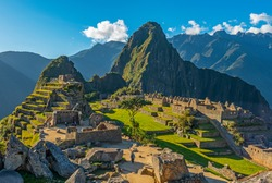 The majestic Machu Picchu at sunset with the last tourists in the lost city of the Inca, Cusco region, Peru, South America.