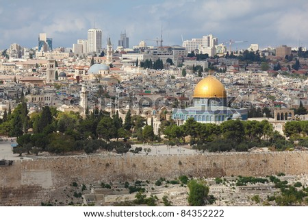 The majestic panorama of Jerusalem. The golden dome of a Muslim mosque and a modern city with skyscrapers