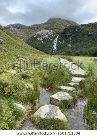 The majestic steall falls, Glen Nevis. A powerful cascading waterfall in the Highlands of Scotland. Fort William. The river Nevis flowing through rugged wilderness and forests. #1501911584