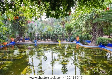 The Majorelle Garden is a botanical garden and artist\'s landscape garden in Marrakech, Morocco.