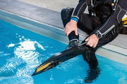 The male scuba diver takes off his fins. Diving? Close up