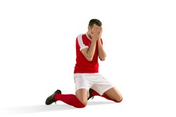 The male unhappy soccer or football player with palm on his face after goal. The professional soccer football and human emotions concept. The fit caucasian active man isolated on white studio