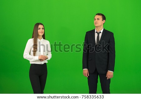 The man and woman stand on the green background stock photo