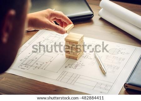 free photos wooden geometric shapes on graph paper avopix com