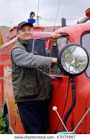 The man by an ancient fire-engine with a lantern