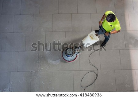 the man cleaning floor with...