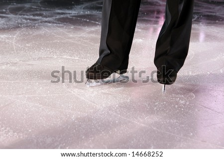 The man figure skater in ice stadium