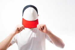the man, guy in the blank white, red baseball cap,  on a white background, mock up, free space, logo presentation , template for print,  design,