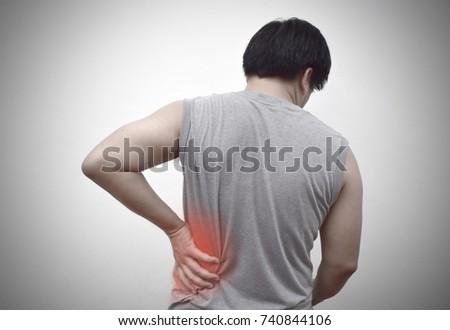 The man holding his waist, paining waist. #740844106