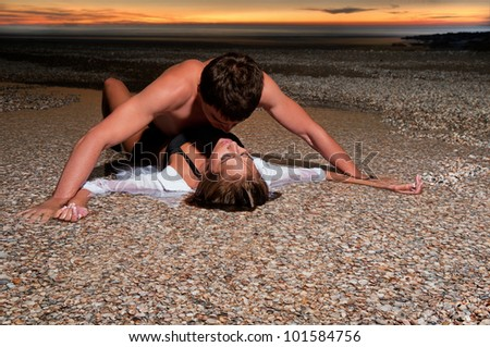 the man holding the girlfriend on her back