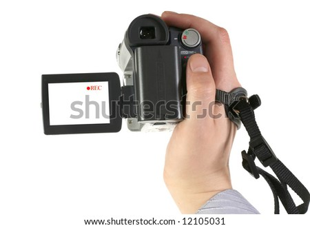 The man holds an amateur digital videocamera