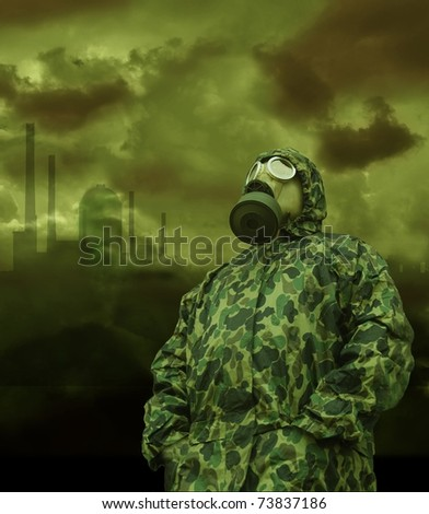 the man in anti-gas mask on a factory background