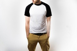 the man in the Blank black white reglan t shirt stand, on a white background