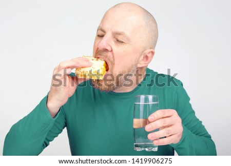 the man is appetizing eats honey. healthy and proper nutrition