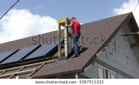 The man is building a chimney Construction and insulation of the roof chimney #1087911332