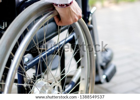 the man is disabled on a wheelchair. nature details stroller. back injury disease is limited. car accident. rehabilitation recovery after injury Photo stock ©