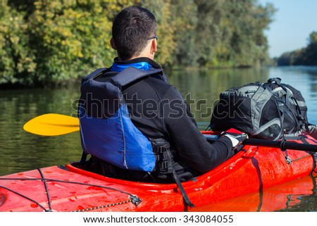 The man is kayaking on the river. #343084055