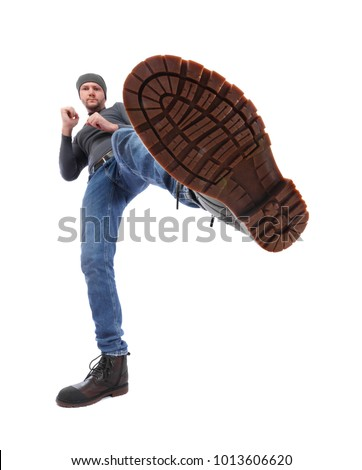 The man is kicking. Foot with a shoe close-up. Corrugated sole of the boot from the bottom up