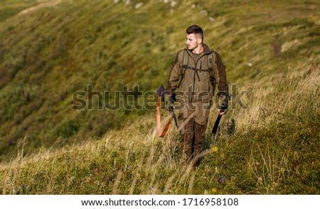 The man is on the hunt. Hunt hunting rifle. Hunter man. Hunting period. Male with a gun. Close up. Hunter with hunting gun and hunting form to hunt. Hunter is aiming.