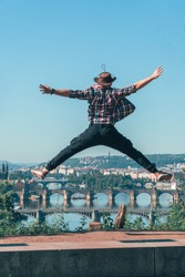 the man jumping with happiness. beautiful view of the old city of Prague, Praha, tourist tour in Europe, vacation. having fun.