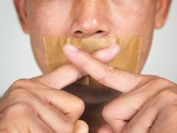 The man making finger on lips silence gesture, pst, shh,