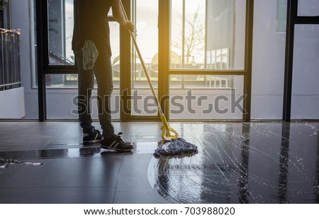 The man mop floor. Stock foto ©