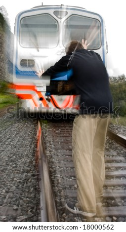 the man on railroad and train with the fast motion blur