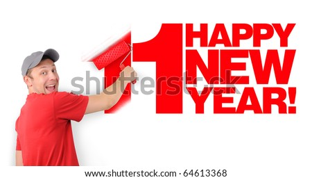 The man paints on a white wall red text happy new year