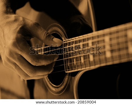 The man playing the guitar
