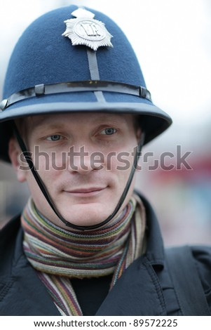 The man posing in british police hat