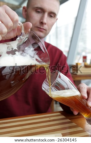 The man pouring a beer in a restaurant