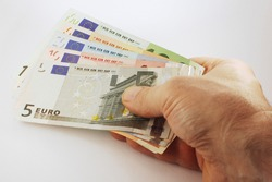 The man's hand holds the set of euro banknotes on white background, Euro currency money, euro