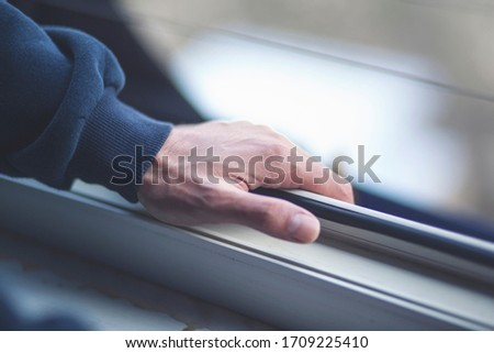 The man's hand opens the window. Ventilating a house in hot weather. Photo stock ©