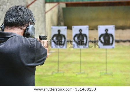 the man shooting with gun