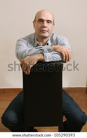 The man sitting on the chair