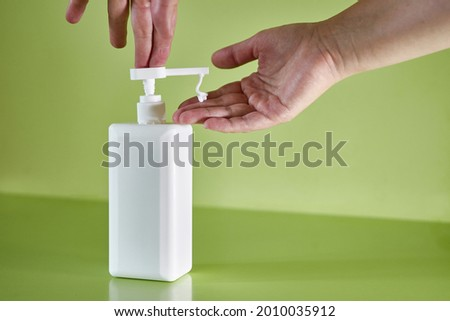 The man squeezes a little cream to care for and protect the skin. Body skin care. Protection against excessive sunburn and skin irritation. Foto stock ©