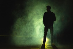 The man standing in the fog. evening night time