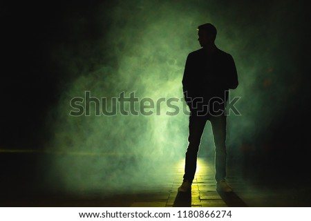 The man standing in the fog. evening night time #1180866274