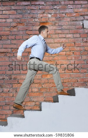 The man walks upwards on a ladder