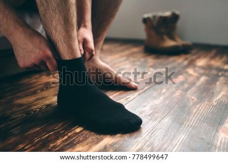 The man wears black socks. Men's style. #778499647
