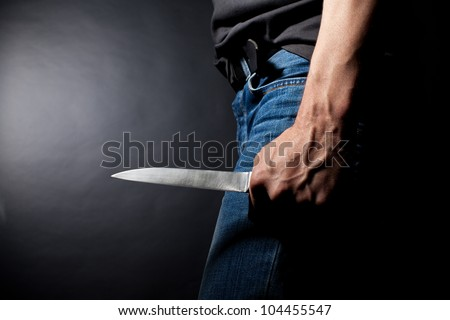 The man with a knife in a hand. Closeup - stock photo