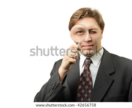 The man with a magnifier. It is isolated on a white background