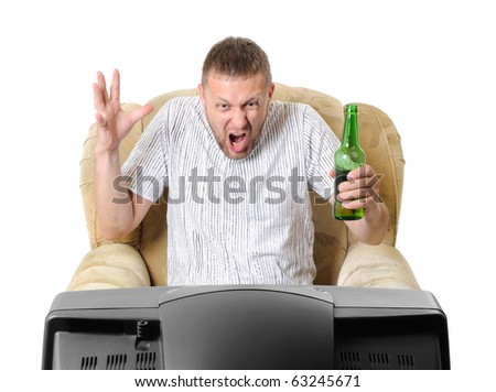 The man with beer in an armchair watches TV isolated on withe background