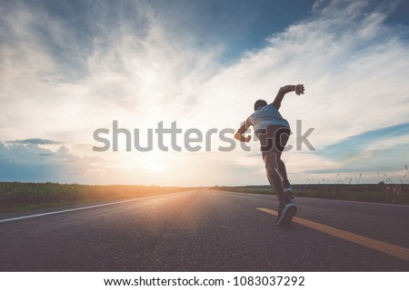 The man with runner on the street be running for exercise. #1083037292