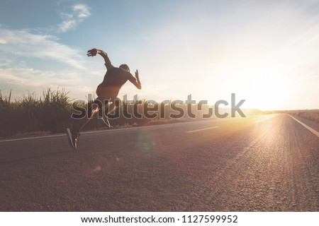 The man with runner on the street be running for exercise. #1127599952