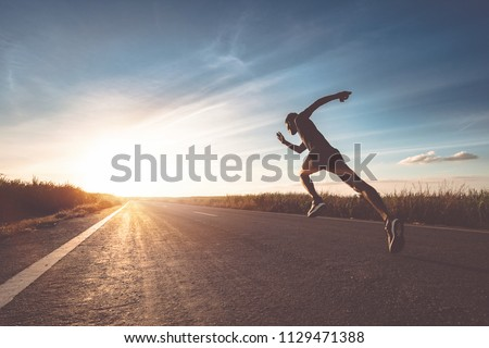 Photo of  The man with runner on the street be running for exercise.